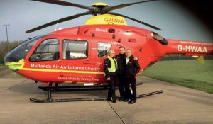 Presenting a cheque for the Midlands Air Ambulance Charity
